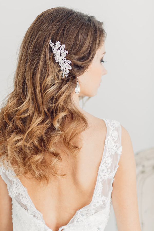 down-wedding-hairstyles-with-bridal-headpieces-for-medium-length-hairs