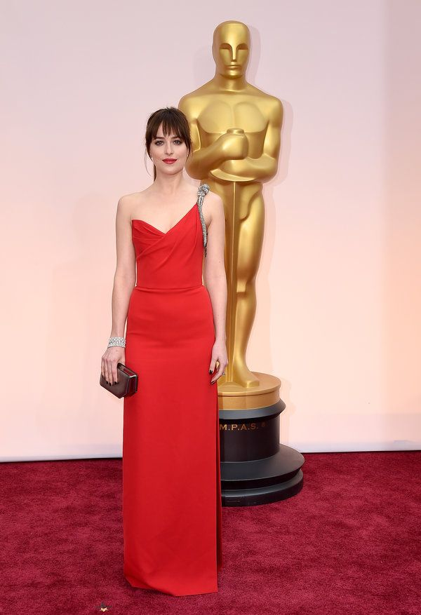 1. Dakota Johnson in a Saint Laurent dress, Forever Mark Diamonds jewelry, and Bally bag (3)