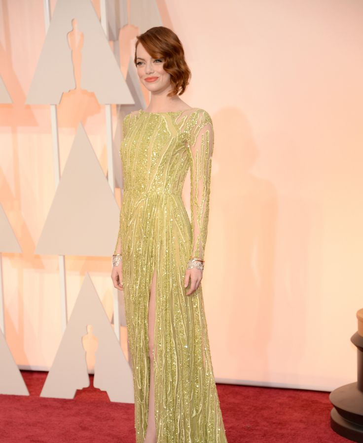 Emma Stone in an Elie Saab Haute Couture dress and Tiffany Blue Book Collection jewelry..